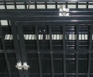 """Close up of 48"""" Heavy Duty Dog Crate Latches and bars"""