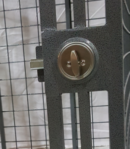 Schlage deadbolt closeup Heavy duty dog crate door.